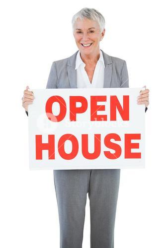 Estate agent holding sign for open house