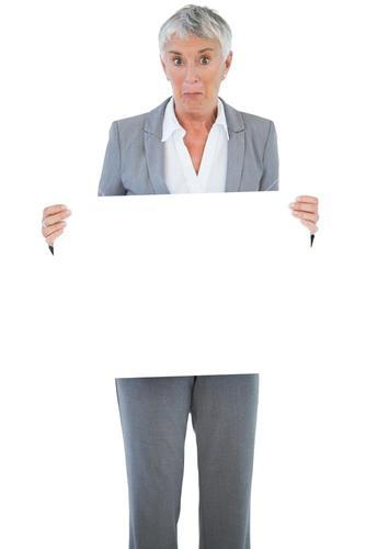 Businesswoman holding blank sign