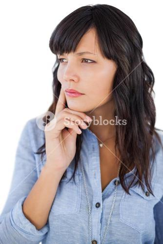 Thinking brunette with finger on her face looking away