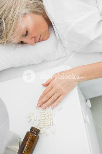 Blonde woman lying motionless after overdosing on pills