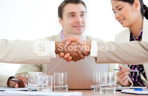 Close up of two business people greeting each other