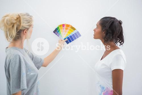 Housemates picking colour for blank wall