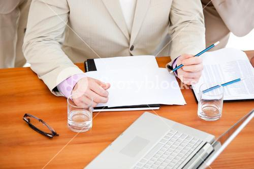 Close up of a businessman working in a meeting