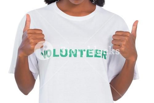 Woman wearing volunteer tshirt and giving thumbs up