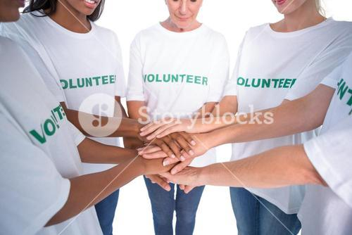 Group of female volunteers with hands together