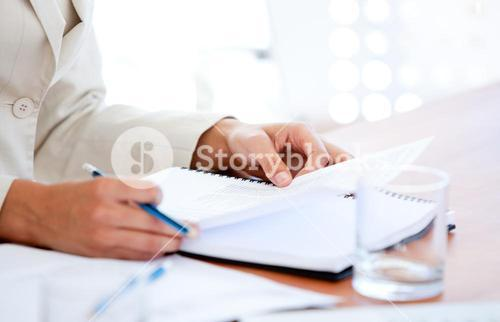 Close up of a businessman studying a contract