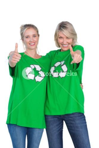 Two happy women wearing green recycling tshirts giving thumbs up