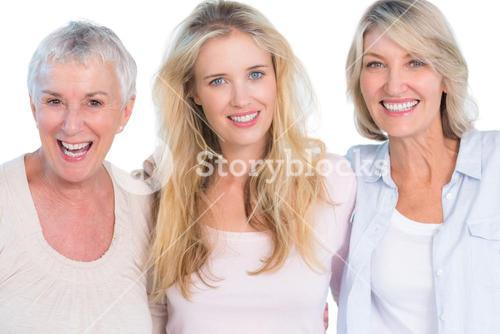 Three generations of cheerful women smiling