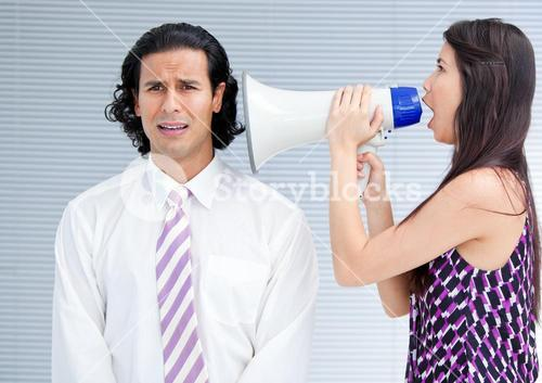 Angry businesswoman yelling through a megaphone