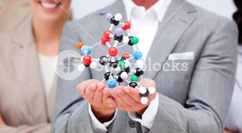 Close up of a businessman holding a molecule