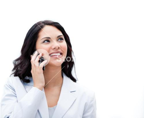 Portrait of a jolly businesswoman phoning