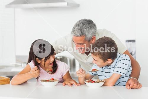 Father talking with his children during their breakfast