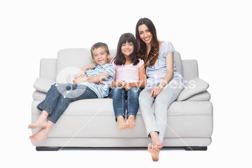 Mother with their children sitting on sofa
