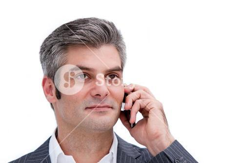 Portrair of a charming businessman on the phone