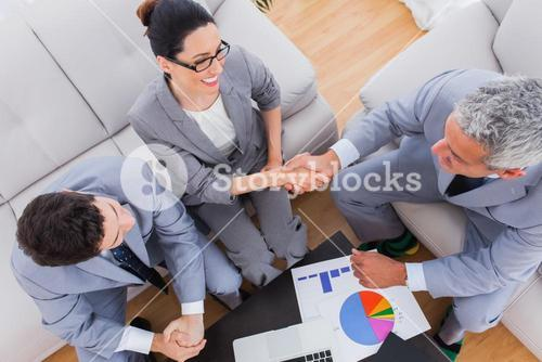 Smiling business shaking hands during meeting