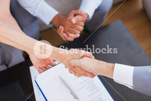 Salesman shaking hand with client