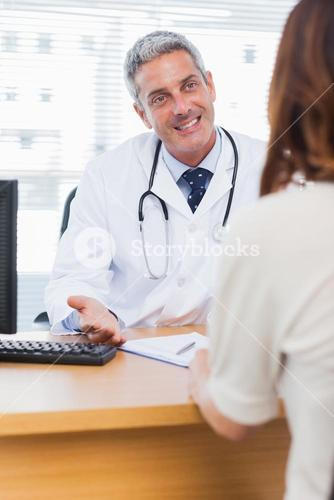 Happy doctor talking with his patient