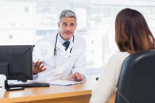 Doctor explaining an illness to his patient