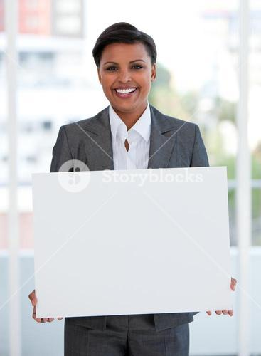 Portrait of a female manager holding a white board