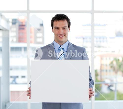 Portrait of a male manager holding a white board