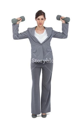 Businesswoman posing with dumbbells