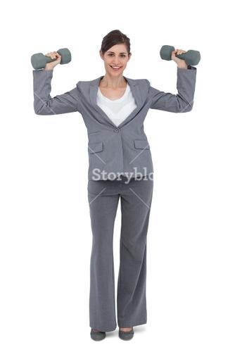 Businesswoman with dumbbells