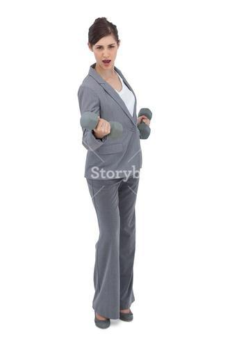 Businesswoman holding dumbbells