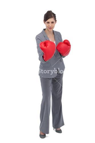 Competitive woman with boxing gloves