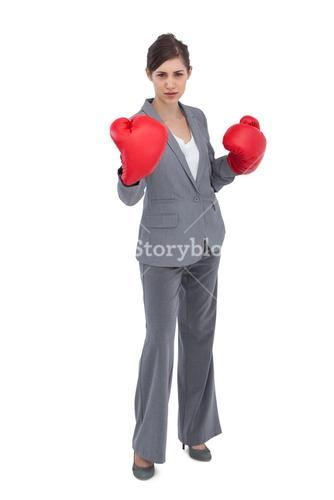 Competitive woman with red boxing gloves
