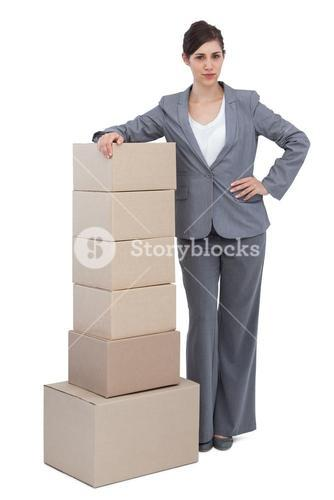 Businesswoman with cardboard boxes