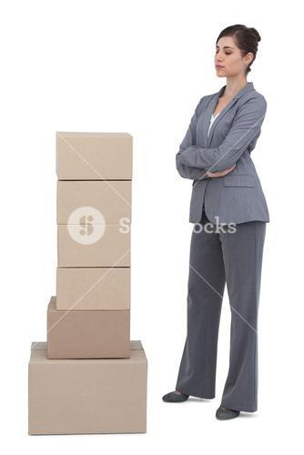 Thoughtful woman with cardboard boxes
