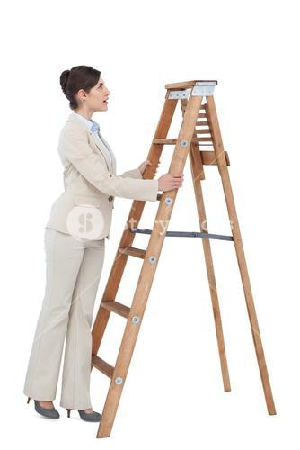 Cheerful businesswoman looking up the career ladder