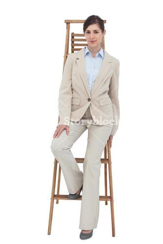 Young businesswoman sitting on career ladder