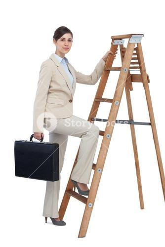 Businesswoman climbing career ladder with briefcase and looking at camera