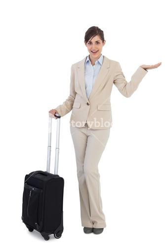 Surprised businesswoman with suitcase