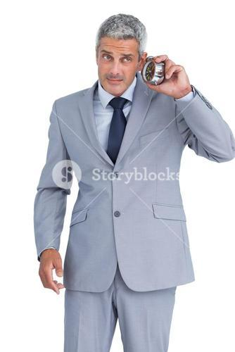Concerned businessman with alarm clock