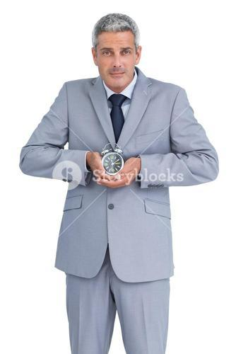 Businessman with alarm clock in both hands
