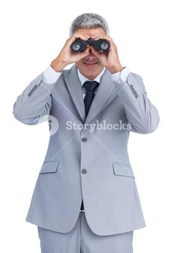 Businessman observing through binoculars