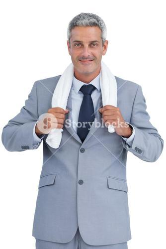 Self assured businessman with white towel on shoulders
