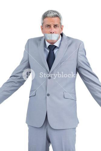 Businessman with adhesive tape on mouth