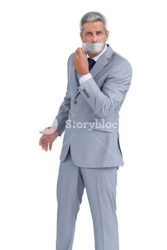 Businessman taking off adhesive tape on mouth