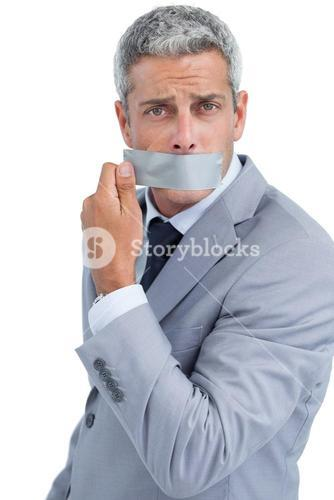 Businessman taking off duct tape on mouth