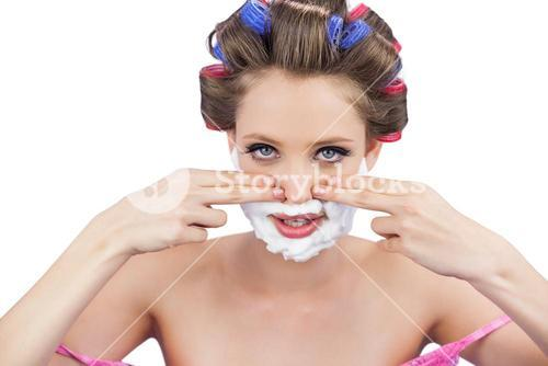 Young model with fingers on face and shaving foam