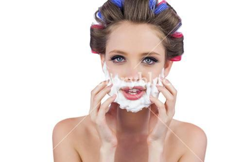 Model touching her face with shaving foam
