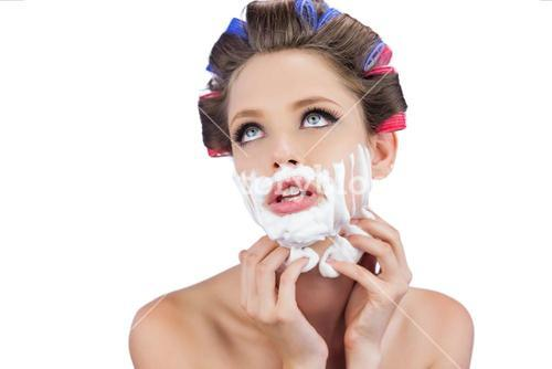 Thoughtful model touching her face with shaving foam