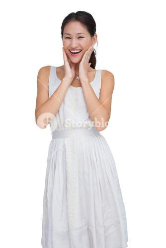 Smiling woman with hands on her face