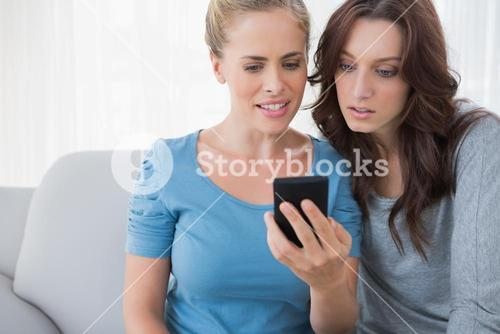 Friends watching something on their phone