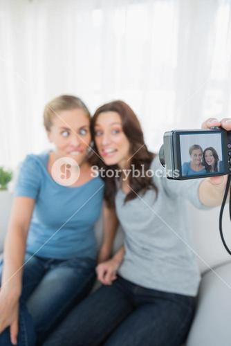 Women making faces while taking pictures of themselves