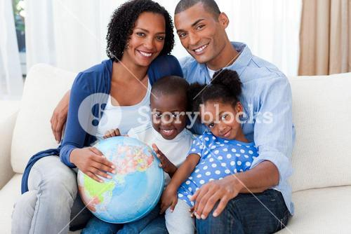 Family holding a terrestrial globe