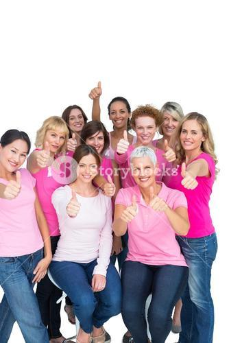 Voluntary cheerful women wearing pink for breast cancer